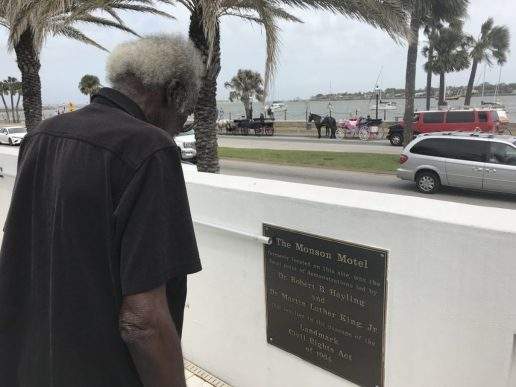 Jimmy Jackson looks at the plaque dedicated to his mentor Robert B. Hayling.
