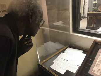Jackson reviews one of his multiple arrest records from his civil rights activism.